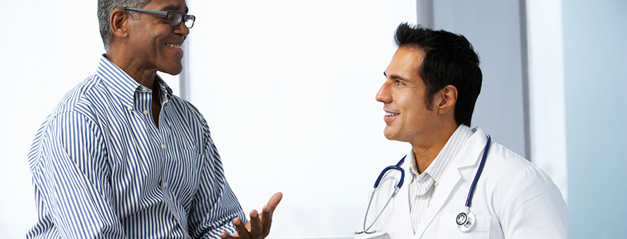 Picture of a man speaking with a doctor.