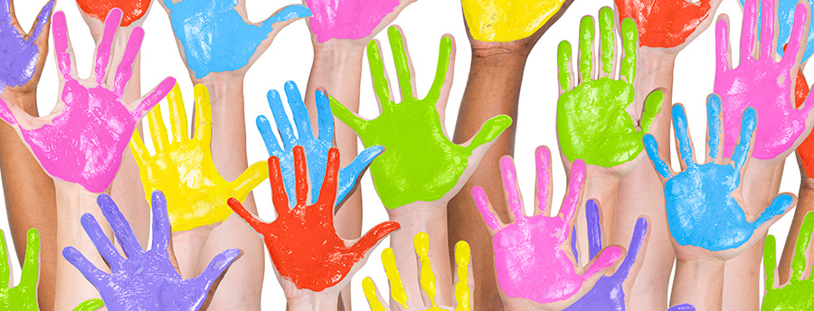 Picture of many hands that are covered in paint (purple, green, blue, yellow, pink, and red)
