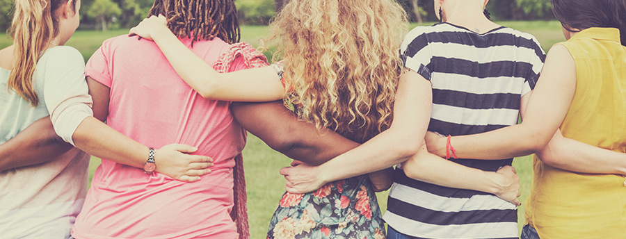 Picture of four teens in a group hug.